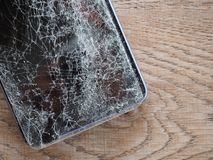 Smartphone screens break from falling ground and space agreement with the concept of accident technology, insurance, repair, maint. Enance. Event over royalty free stock images