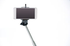 Smartphone on a selfie stick Royalty Free Stock Photos