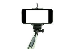 Smartphone on a selfie stick shot in studio 1. Smartphone on a selfie stick shot in studio Royalty Free Stock Image