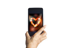 Smartphone send photos of heart bokeh on isolated background Stock Image