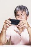 Smartphone and senior man at home Royalty Free Stock Photo