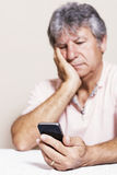 Smartphone and senior man at home Stock Photo