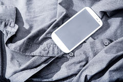 Smartphone on a shirt Stock Photography
