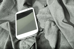 Smartphone on a shirt Royalty Free Stock Photo