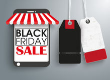 Smartphone Shop 2 Price Stickers Black Friday. Smartphone with price stickers on the gray background Royalty Free Stock Photos