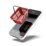 Smartphone with shopping basket Royalty Free Stock Photo