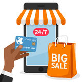 Smartphone Shopping with Orange Bag Royalty Free Stock Photos