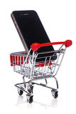 Smartphone in shopping trolley Stock Photos