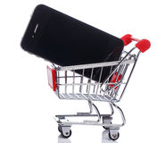 Smartphone in shopping trolley Stock Image