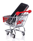 Smartphone in shopping trolley Stock Photo