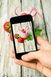 Smartphone shot food photo. Strawberries and a glass of yogurt royalty free stock photo