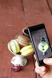 Smartphone shot Italian almond macaroons with espresso Stock Photography