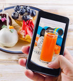 Smartphone shot photo - healthy and unhealthy food concept Royalty Free Stock Image