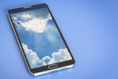 Smartphone. Smartphone, showing cloud computing concept on screen, blue background Royalty Free Stock Photo