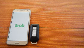 Smartphone showing GRAB application Stock Photos