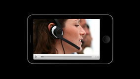 Smartphone showing team working together stock footage