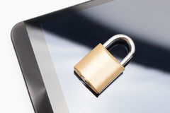 Smartphone with small closed lock. Mobile phone security and data protection concept Stock Photo
