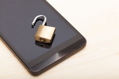 Smartphone with a small unlocked lock. Mobile phone security and data protection concept. Smartphone with a small unlocked lock over it. Mobile phone security Royalty Free Stock Photo