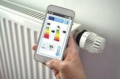 Smartphone with smarthome control app with energy efficiency classes stock photo
