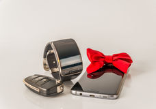 Smartphone with smartwatch and car key, exclusive black set, whi Royalty Free Stock Photos