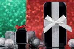 Smartphone and smartwatch for Christmas Stock Images