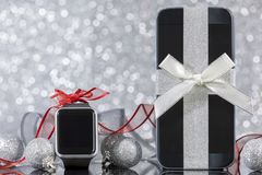 Smartphone and smartwatch for Christmas Royalty Free Stock Images