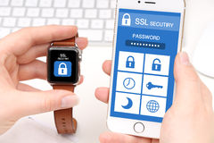 Smartphone and Smartwatch with security app Stock Photos