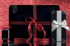 Smartphone and smartwatch and tablet pc with decorations Royalty Free Stock Images