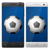 Smartphone soccer Stock Image