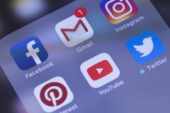 Smartphone with social media apps YouTube, Facebook, Instagram, Google, Gmail, Twitter, Pinterest, WhatsApp. Russia - October 04 royalty free stock photo