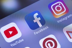 Smartphone with social media apps YouTube, Facebook, Instagram, stock image