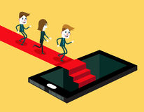 Smartphone and social media mania. Group of people running on red carpet to inside smartphone. Royalty Free Stock Photography