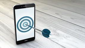 Smartphone sopra fondo di legno bianco con l'obiettivo Fotografie Stock Libere da Diritti