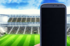 Smartphone at stadium Royalty Free Stock Image