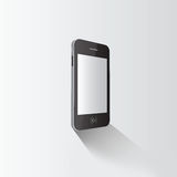 Smartphone standing on grey surface Stock Images