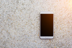 Smartphone on stone table. royalty free stock image