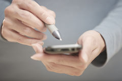 Smartphone and stylus Stock Photos