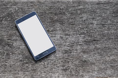 Smartphone su fondo di legno con lo spazio della copia Fotografia Stock Libera da Diritti