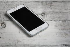 Smartphone su priorità bassa bianca Fotografia Stock Libera da Diritti