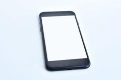 Smartphone su priorità bassa bianca Immagini Stock