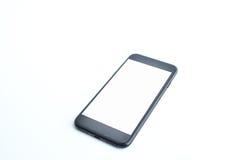 Smartphone su priorità bassa bianca Fotografia Stock