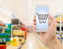 Smartphone in supermarket Stock Photo