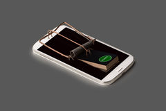 A smartphone symbolically as mousetrap with trigger Royalty Free Stock Photography