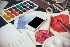 Smartphone on a table in the artist studio Royalty Free Stock Photo