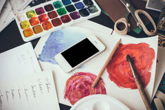 Smartphone on a table in the artist studio Stock Photos