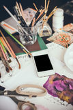 Smartphone on a table in the artist studio Royalty Free Stock Photography