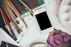 Smartphone on a table in the artist studio Royalty Free Stock Photos