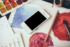 Smartphone on a table in the artist studio Stock Photography