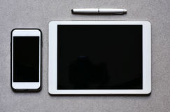 Smartphone and tablet with a black blank space Royalty Free Stock Photos