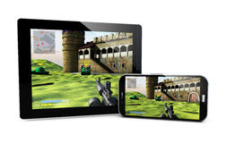 Smartphone and tablet gaming Royalty Free Stock Photography